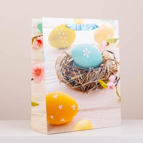 Húsvéti dísztasak virág és festett tojás mintával, csillámporos nagy (32x26x10cm)