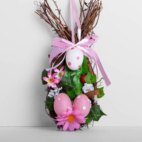 Húsvéti koszorú dekoráció tojással és szalaggal