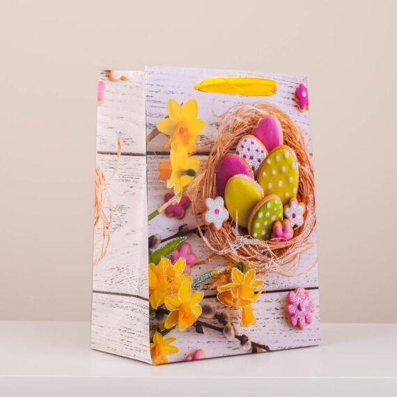 Húsvéti dísztasak virág és festett tojás mintával, csillámporos közepes (23x18x9) YS779726